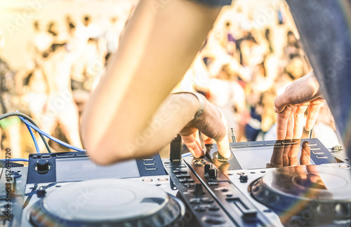 Close up of dj playing electro sound on modern cd usb player at summer beach par Poster