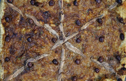 Staande foto Nice A French pissaladiere tart with onions, nicoise olives and anchovies