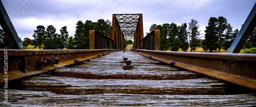 Old rusty weathered railway bridge