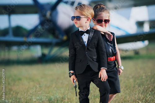 young boy and girl playing spy Poster