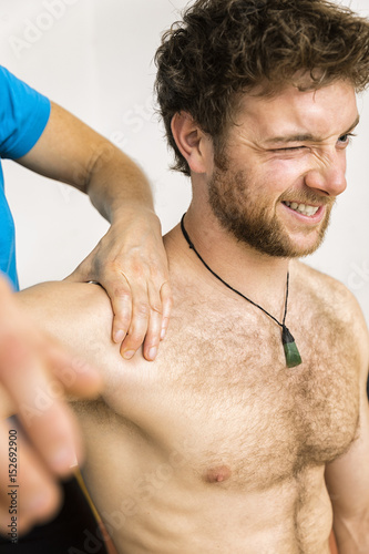 young man at the physio therapy with pain
