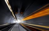 Traffic speeding through a modern tunnel. Speed concept.