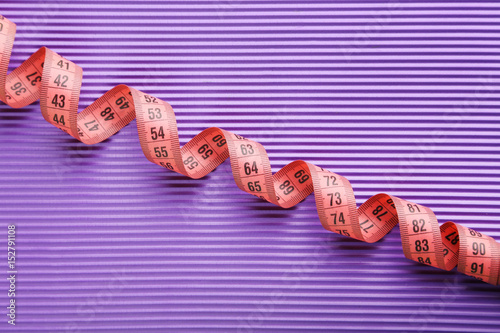 Poster Measure tape on purple background