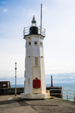 A view of the lighthouse on the harbour pier at Anstruther, Fife, East Neuk, Scotland - 152792702