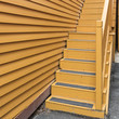 Gold colored external stairs with railings, Nova Scotia, Canada