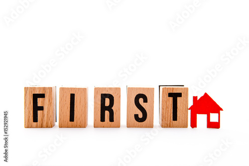 Poster First Home - wooden block letters and red home icon on white background