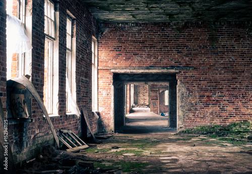 Fotobehang Oude verlaten gebouwen The view from an old, abandoned factory on the courtyard. Old plant background.