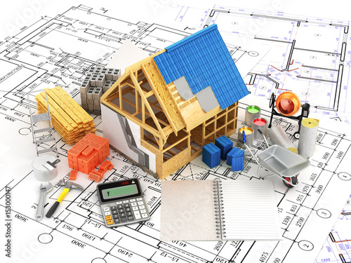 Fototapeta building and construction materials located on top of the drawings. 3D illustration