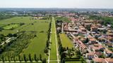 Nuovo Skyline di Milano visto dall'hinterland milanese, vista aerea, viale alberato, percorso ciclo pedonale. Varedo, Monza Brianza, Lombardia. Italia