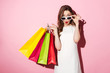 Quadro Shocked young brunette lady with shopping bags