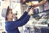 Female customer reaching food from vendor - 153033358