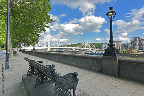 Chelsea Embankment on the River Thames and Albert Bridge with summery, blue, cloud flecked sky Poster