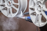 Process of powder coating wheels - 153089900