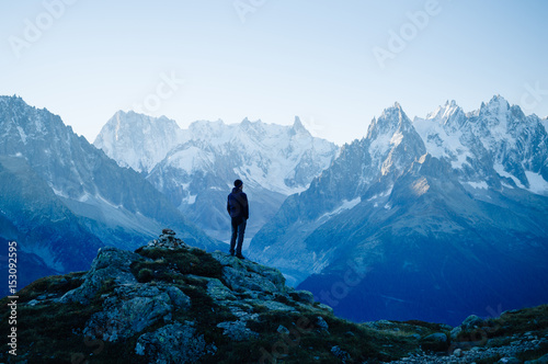 Man looking at the mountains near Chamonix, France. Old film style.
