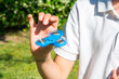 Child playing with a blue fidget spinner