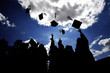Graduates tossing hats in the blue sky