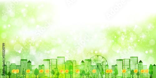 ひまわり 新緑 ビル 背景
