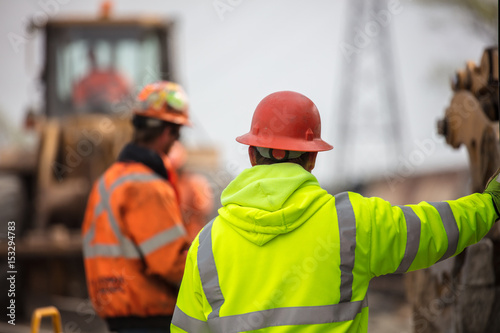 construction supervisor reviewing construction work