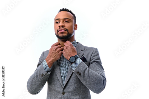 Poster An elegant black male dressed in a suit isolated on white background