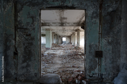Fotobehang Oude verlaten gebouwen Inside destroyed building, ruins of factory, long corridor, perspective