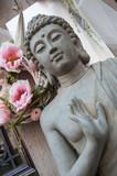 détail bouddha en décoration chez un fleuriste dans la rue