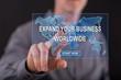 Man touching a worldwide business development concept on a touch screen