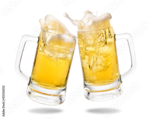 Fototapeta Cheers cold beer with splashing out of glasses on white background.