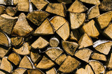 Firewood. Walls. Wooden background
