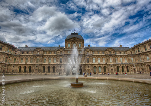 Louvre Palace at Paris in summer Poster