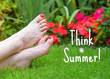 Inspirational quote 'Think Summer' ina garden setting.