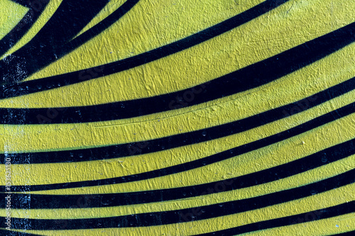 Fototapeta Stylish fragment of wall with detail of graffiti, street art. Abstract creative drawing fashion colors. Closeup painted wall of the city. For background