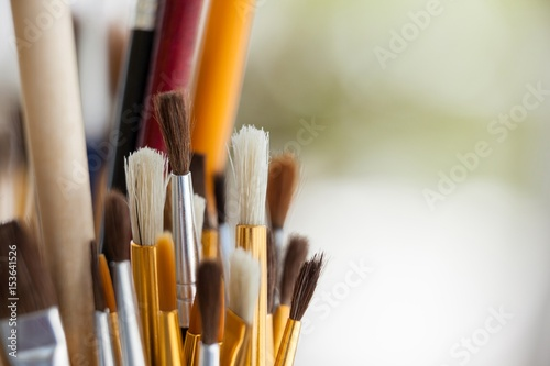 Set of paint brushes in a jar Poster