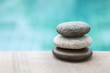Closeup natural texture zen stone on swimming pool edge, spa decorate concept