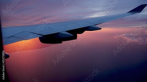 Sunrise over San Francisco Bay Water turns into reddish orange liquid as the sun rises above the San Francisco Bay, seen from an airplane window.