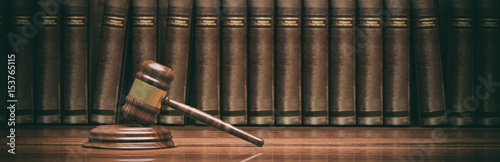 Fototapeta Wooden judge gavel and law books. 3d illustration