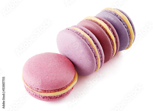 Colorful French almond cookies macarons or macaroons isolated on white background Poster