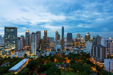 Aerial view of Bangkok City skyline at sunset with skyscrapers of midtown bangkok, Thailand.
