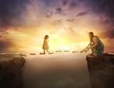Child walking on pages over cliff - 153868943