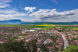 Spring view over Rasnov city, in Brasov county (Romania), with Piatra Craiului mountains in the background