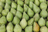 Pears on the counter for sale in a vegetable shop.