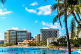 Waikiki Beach, with its many resorts under blue sky and white sand, makes it one of the world's most famous beaches. Located in Honolulu on the Hawaiian island of Oahu  - 153979722