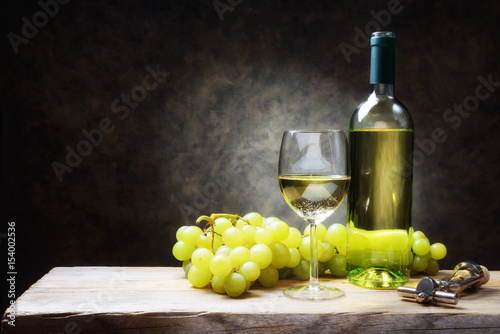 White wine with bunches of grapes