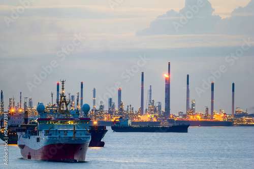 Survey and Cargo Ships off the Coast of Singapore Petroleum Refinery Poster