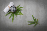 Gray stones in bowl with bamboo leaf,towel gray background