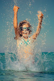 Happy child playing in the sea - 154149729