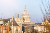 Cityscape of London with St. Paul's Cathedral against blue sky