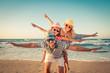 Quadro Happy family having fun on summer vacation