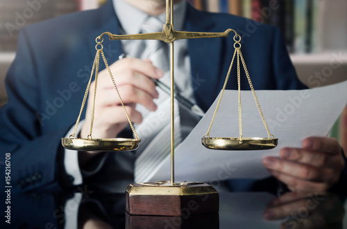 Fototapeta Weight scale of justice, lawyer in background