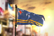 Постер, плакат: Aruba Flag Against City Blurred Background At Sunrise Backlight
