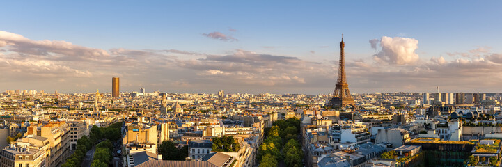 Panoramic summer view of Paris rooftops at sunset with the Eiffel Tower. 16th Arrondissement, Paris, France